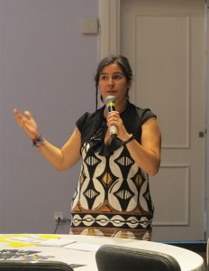 María Muñoz, WILPF Human Rights Director, shares from the Economies and Corporations breakout session. Photo: Orla Sheridan.