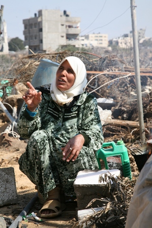 Photo of woman in ruined kitchen in Gaza