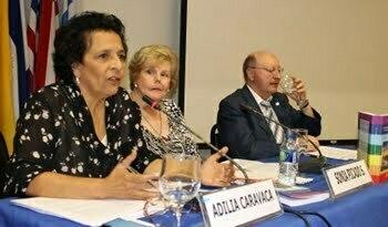 Photo of Adilia Caravaca speaking at sympsium