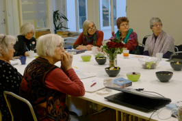 WILPF Norway members sitting listening to presentation