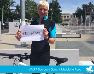Madeleine Rees holding Time to act sign